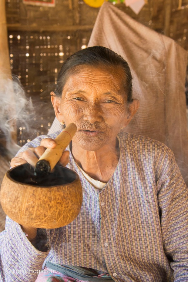 Woman smoking a cheroot,  Myanmar.